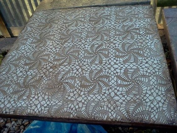by Elena Eidelberg - Patterned Concrete Table  She works in ceramics but has been experimenting a lot with concrete this year and I think she's been making some amazing stuff. She's casting into high relief fabrics and then tinting the concrete and even gilding it sometimes.