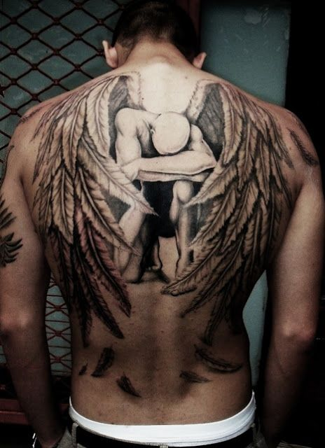 Sad angel with wings tattoo on back:
