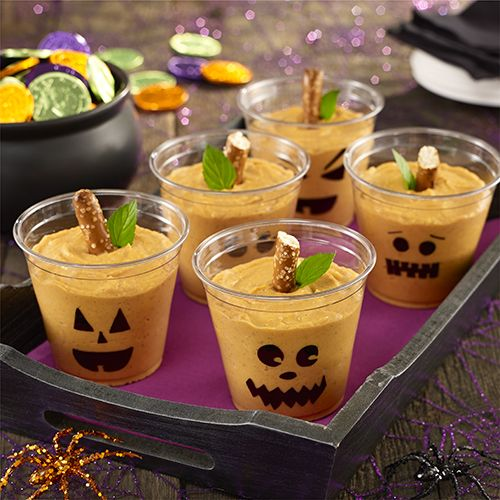 Halloween Pumpkin Pudding Cups: A Halloween dessert recipe with vanilla pudding, pumpkin, cream cheese and spices mixed together and served in a decorated cup: