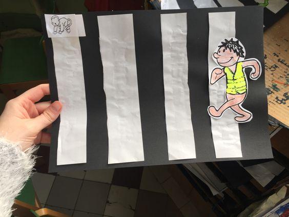 Knutselwerkje: oversteken op het zebrapad. Met fluohesje (fluo verf)