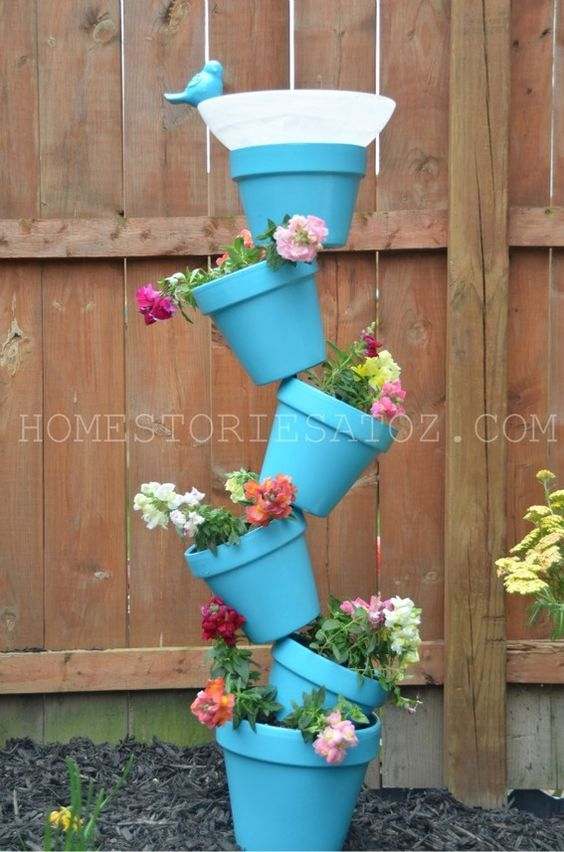 like these blue pots & flowers  (vertical planter...)