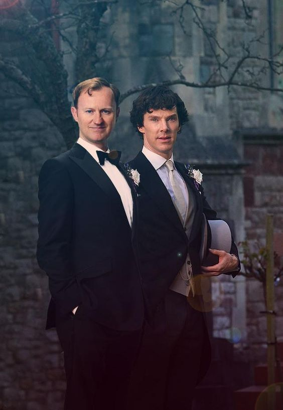Ahh, look at all of the Pre-Series 3 speculation.  How young we all were: Mycroft is wearing a boutinere (sp?) identical to Sherlock's, but not a tie nor a top hat. The identical flowers mean they're both in the wedding party, but in which roles? Sherlock is dressed more formally (see: top hat) so he is most likely more essential to the ceremony. But it I recall correctly, John's outfit is identical to Sherlock's. WHAT DOES THIS MEAN?