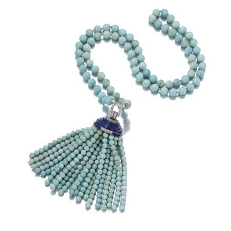 Turquoise, lapis lazuli and diamond sautoir, Van Cleef & Arpels, 1929. photo Sotheby's    The tassel of turquoise beads to a circular stepped lapis lazuli surmount embellished with millegrain-set single-cut diamonds, suspended from a plain turquoise bead necklace