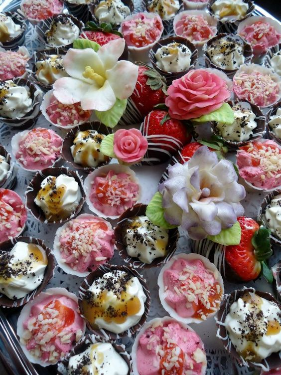 White Chocolate Cups filled with Raspberry Mousse topped with Mango Sauce & Coconut, Chocolate Cup filled with Banana Mousse topped with Caramel & Cookie Crumbs ... along with hand-made White Chocolate Flowers colored with edible dust.    https://www.facebook.com/DessertsByJessica