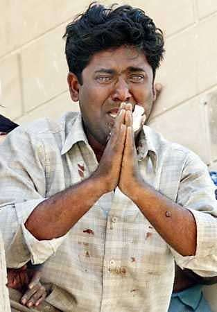 Qutubuddin Ansari, a tailor, pleading with the police to save him from a mob during the Gujarat riots of 2002.