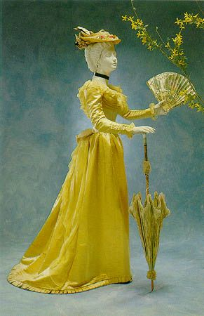 yellow 1891 dinner dress by Worth - not sure about the fan AND umbrella AND hat.  Seems a bit incongruous for a dinner dress.