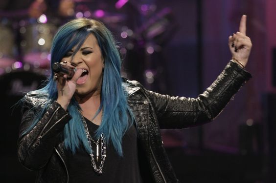 "Feelin' blue. Demi Lovato soars high with a new 'do during a performance on ""The Tonight Show With Jay Leno"" on Oct. 2 in Burbank, Calif.�"