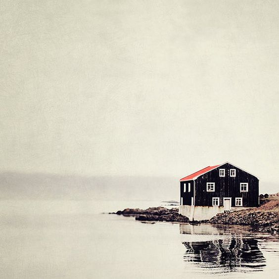 Isolated Black and Red House on Water, Iceland