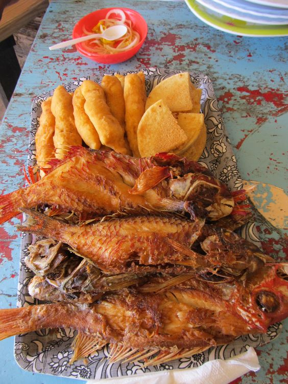 Hellshire Beach's famous Fried Fish, Festival and Bammy (Kingston, Jamaica).  Don't forget the onion pickle.  This would be my 'last supper'.  It simply can't be bettered