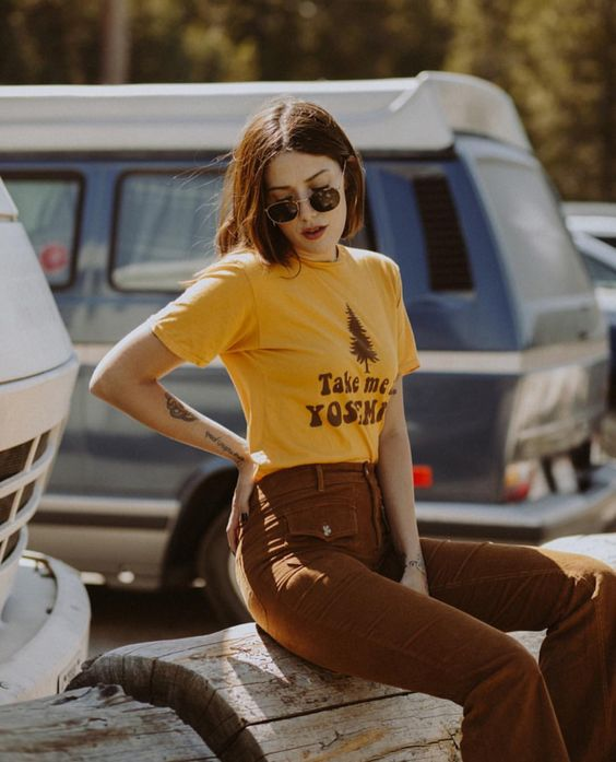 Take me to Yosemite please! Our 1970's inspired tee in marigold yellow. Perfect to pair with some high waist pants. @marinaabadjieff shot by @pedrobeck