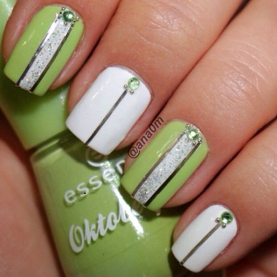 Green and white nail polish combination with silver aluminum lines, silver dust and green beads added on top.