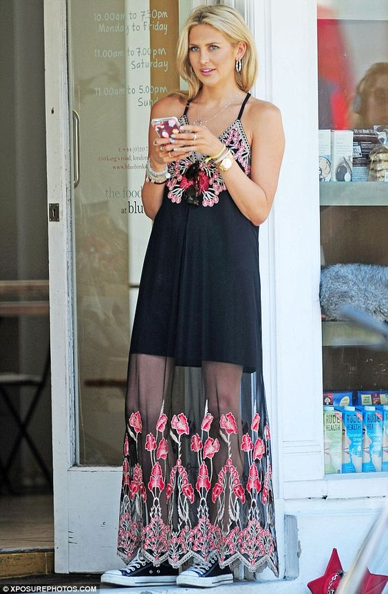 Boho beauty: Stephanie Pratt, 30, flashed her legs in an embroidered maxi…