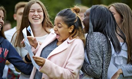 Students at St Bede's College Manchester celebrate their GCSE results. Photograph: Mark Waugh