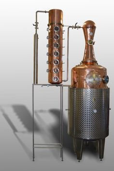 Steam-jacketed copper pot still with whiskey helmet and 6-plate column