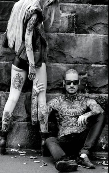 Girl with long blonde with a hot guy covered in tats = me in the future