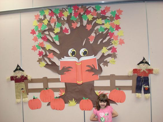 Love his eyes! Holding a book, post books we've read on leaves. Scenery around the tree and at base changes seasonally