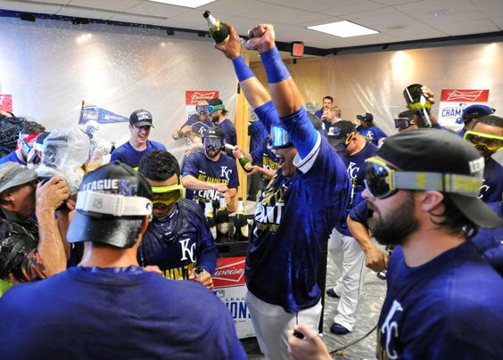 Oct 15, 2014; Kansas City, MO, USA; Kansas City Royals catcher Salvador Perez (middle) celebrates with teammates in the clubhouse after game four of the 2014 ALCS playoff baseball game against the Baltimore Orioles at Kauffman Stadium. The Royals swept the Orioles to advance to the World Series. (Peter G. Aiken-USA TODAY Sports)