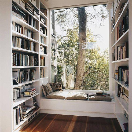 Window seats right in between bookshelves! Amazing!