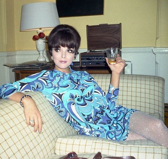 Joan Collin OBE Loving my #whiskey and rocking my @emiliopucci on #throwbackthursday