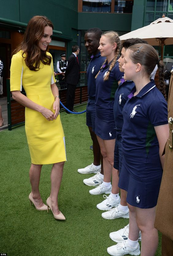 The Duchess looked pleased to be introduced to bally boys and girls (left to right)Dominic Barnaby, Olivia Mallett, Thomas Morais and Anissa Mayouf ahead of taking her seat on Centre Court