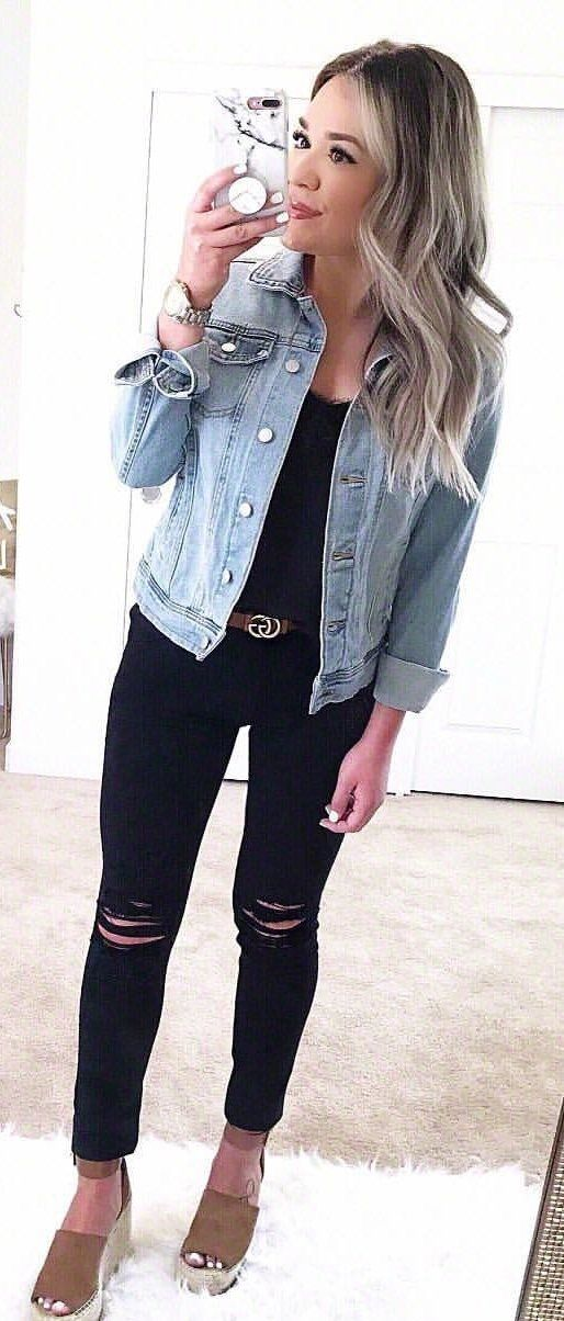 woman wearing blue button up denim jacket and distressed