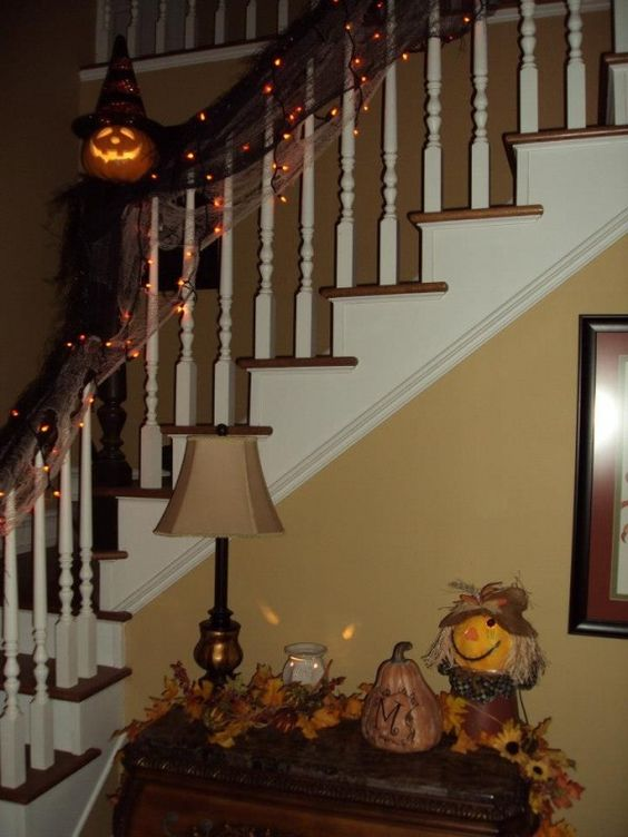 Interior,Simply Atrocious Halloween Staircase Decorating Ideas Using Screw Wooden Banister Feel Horrible With Net Lights Decoration And Ghost Pumpkin Sculpture,Funny Horrible Halloween Staircase Decorating Ideas