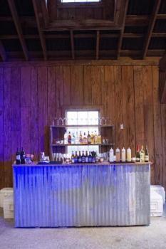 """Corrugated Tin Bar 44"""" H x 96"""" W x 25"""" D"""