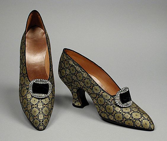 Gold and black brocaded silk pumps with rhinestone buckles, attributed to Grantoni, French, ca. 1920.