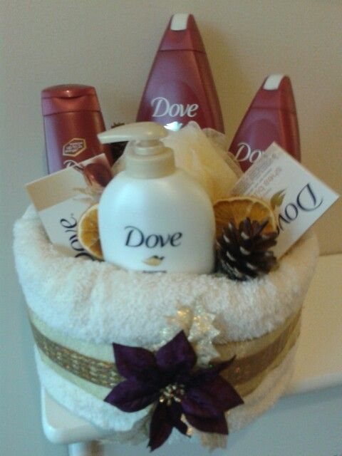Christmas pamper cake;  I glued cardboard onto a circular base & wrapped with a handtowel secured with pins. Filled with dove products & added festive touches.