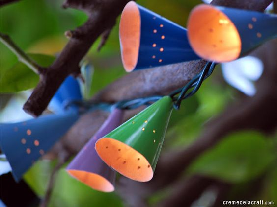"""""""birthday party hats"""" to make a set of cafe string lights. Photo from creme de la craft  on Babble -10-best-diys-of-the-week"""