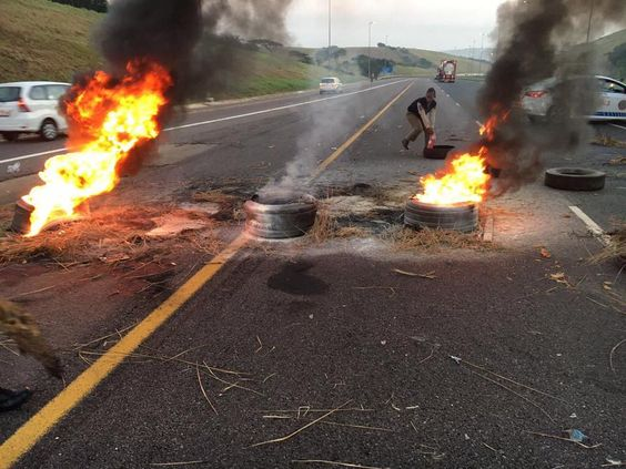 Umdloti bridge - Protesters burning tyres & stoning cars from trafficlights as you approach or come off N2 - Just another regular day in the country.