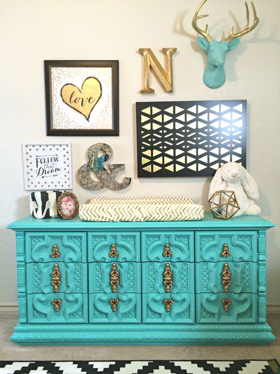 This vintage dresser painted aqua is a such a show-stopper in this black, white and gold nursery! LOVE.