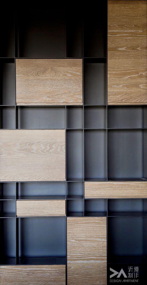 dark cabinets on a dark wall.
