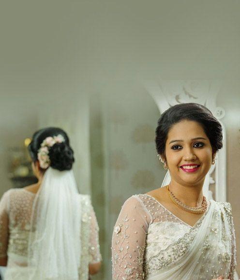 Christian Bridal Netsaree With Floral Highlights And Pearl Work Christian Bridal Saree Christian Bride Christian Wedding Sarees
