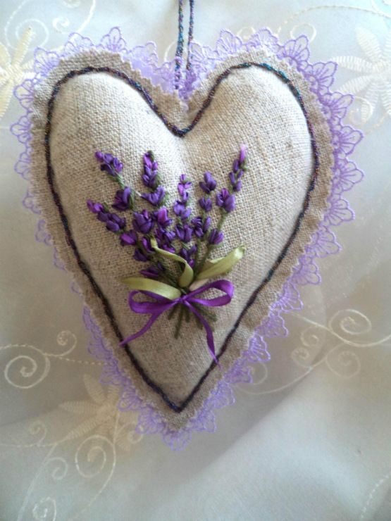 embroidered heart -- I think I'll omit the lace edging. The embroidery is beautiful.