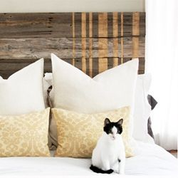 A combination of rustic and glam, spruce up your bedroom with a fence-inspired headboard with gold racing stripes. #dwellinggawker