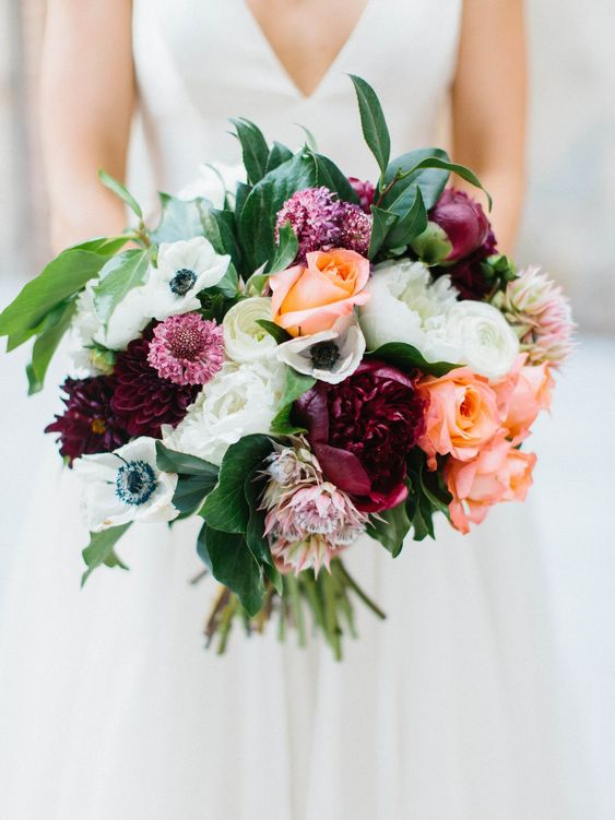 Bright blooms keep this fall wedding bouquet playful while also timeless. 🎶 #WeddingBouquets #Wedding #Bouquet #BridalBouquet #WeddingFlowers #Weddings #Flowers #WeddingInspiration #WeddingIdeas