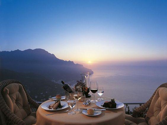 """A former 11th century palace set on cliffs beside the Amalfi Coast, Belmond Hotel Caruso seems to drift on a..."