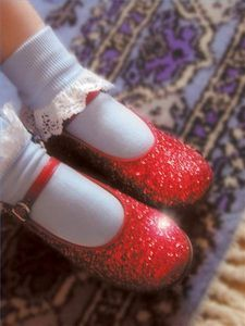 Homemade Wizard of Oz Costumes ~ take a pair of white shoes and spray paint red glitter on them.