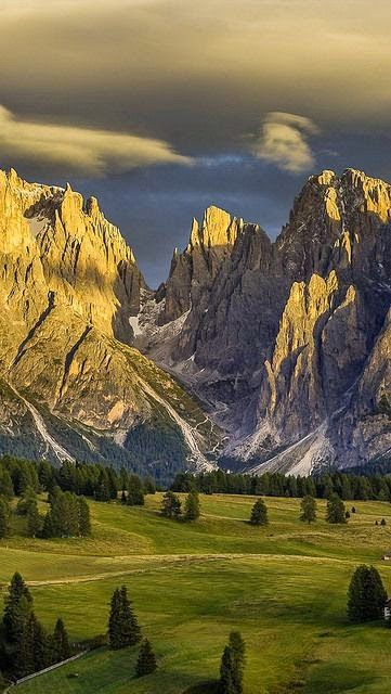 Dolomites, Northern Italy A Giant by luck..Cloud formation on RHS form head of man reachondow to pick something up at his Mountainous foot