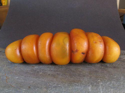 7 ANTIQUE NATURAL AMBER beads. YEMEN