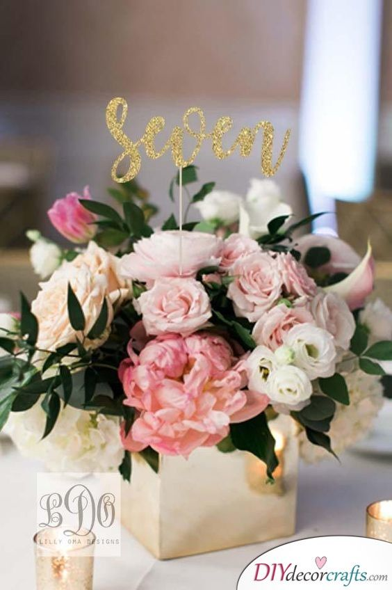 Glittery Numbers Great Diy Table Centerpiece Ideas Flower Centerpieces Wedding Wedding Floral Centerpieces Wedding Table