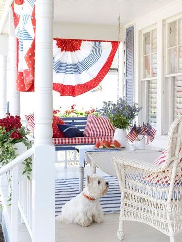 Patriotic decor ideas. Decorate your porch with red white and blue bunting for Independence Day. Add some red geraniums and a cute white Westie. #patriotic #decor #ideas #porch