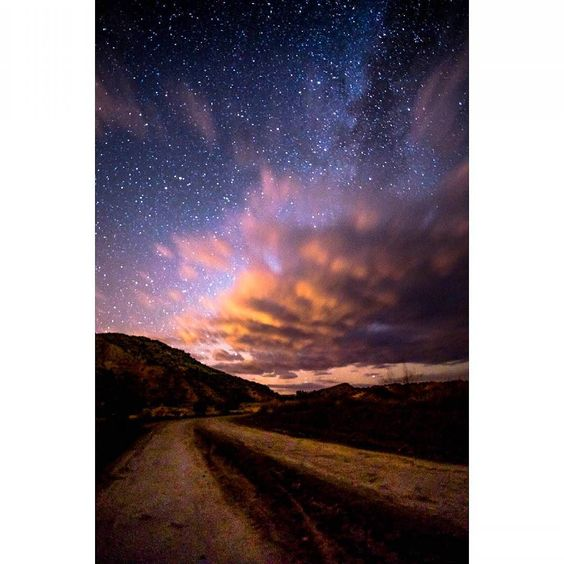 Clouds decided to photo bomb last night :) I took this 50 mins outside the city off of highway 550. It's my first shot with the 16mm I bought. Though the clouds interfered I can see a huge difference in quality.  Klausjames.com #Pentax #igersabq #instagramersnm #nmoutdoors #abqphotos #travelnm #longexposure_shots #milkyway by klaus_1231