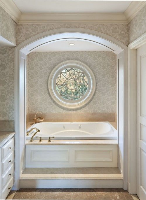 Like the round window in the arched tub area, but since I probably cannot put a window in mine, maybe I can do a round mirror.  Sunburst?