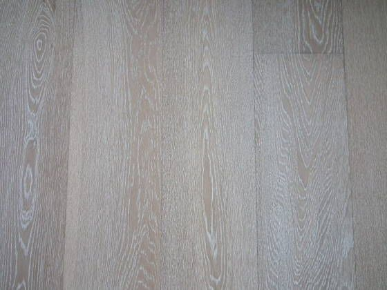 Brushed white wash oak engineered wood flooring will work White washed wood flooring