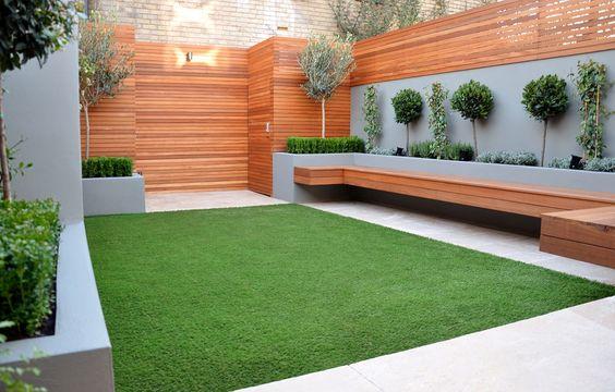 Rectangular lawn as carpet in a contemporary Chelsea garden design 2015.