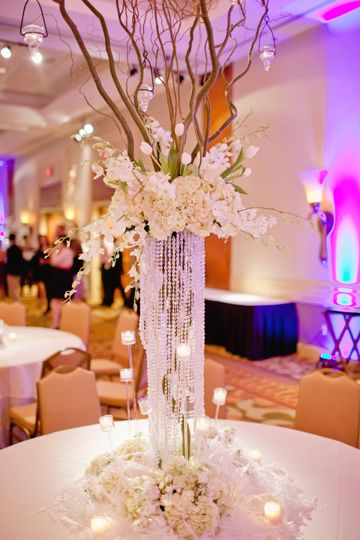 Gorgeous wedding centerpiece using flowers branches