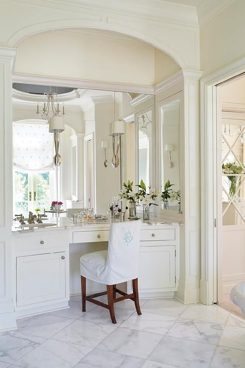 Elegant Master Bathroom Features Arched Alcove Filled With An Ivory Built In Makeup Vanity Fit Master Bathroom Decor Bathroom Decor Bathroom With Makeup Vanity