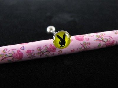 Playboy Tongue Ring Bar Barbell 14g 19mm Black Bunny Head on Yellow Background